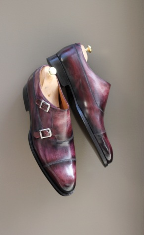 A pair of hand-patinated leather monk straps by Septíème Largeur.