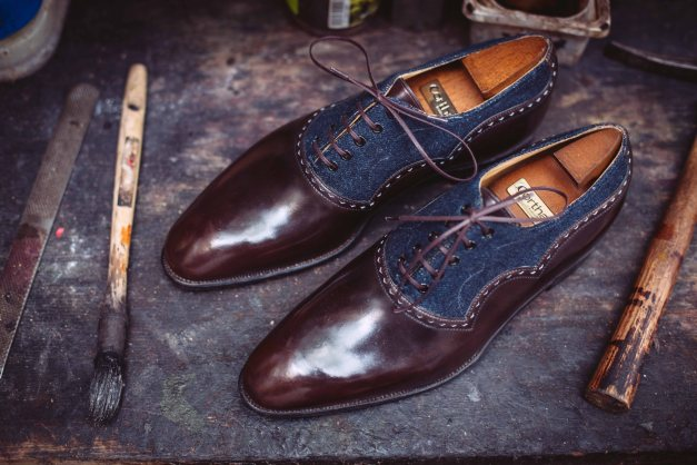 A hand-patinated leather lace-up with a touch of denim on the upper.